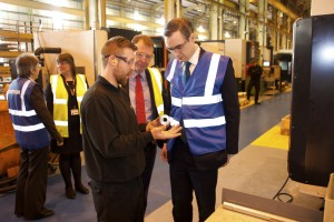 James Wharton MP discussing a machined product with Chris Watson, CNC Machinist